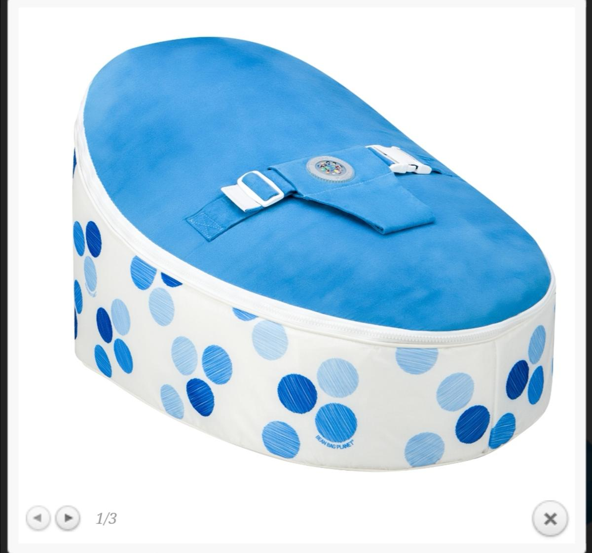 Blue spotty bean bag with additional child strap cover.  hardly ever used, sat behind sofa now.  Covers are all washable, and Interchangable so you can change the design on the bottom and colours of the top panels.  please see here a link to website where u can see all the colours etc