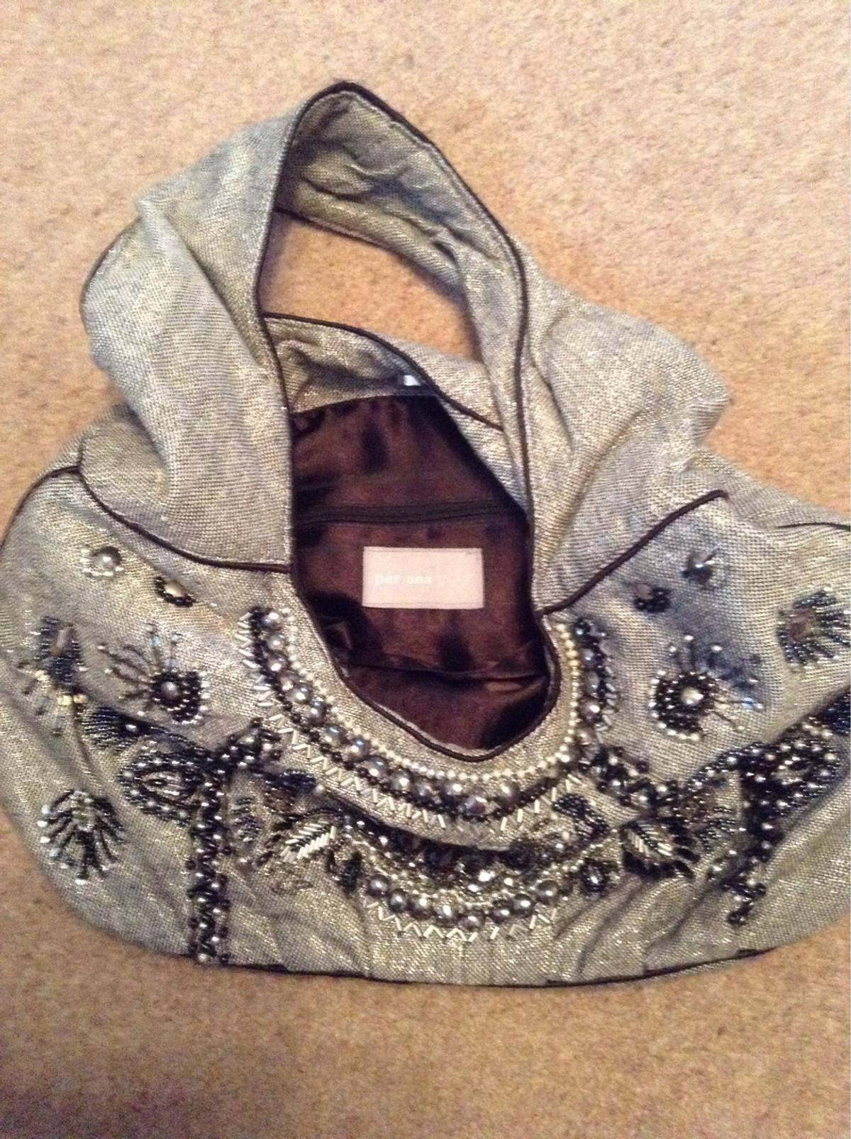 A lovely black and silver jewelled bag, made by Per Una. Used only a couple of times. Cash on collection.