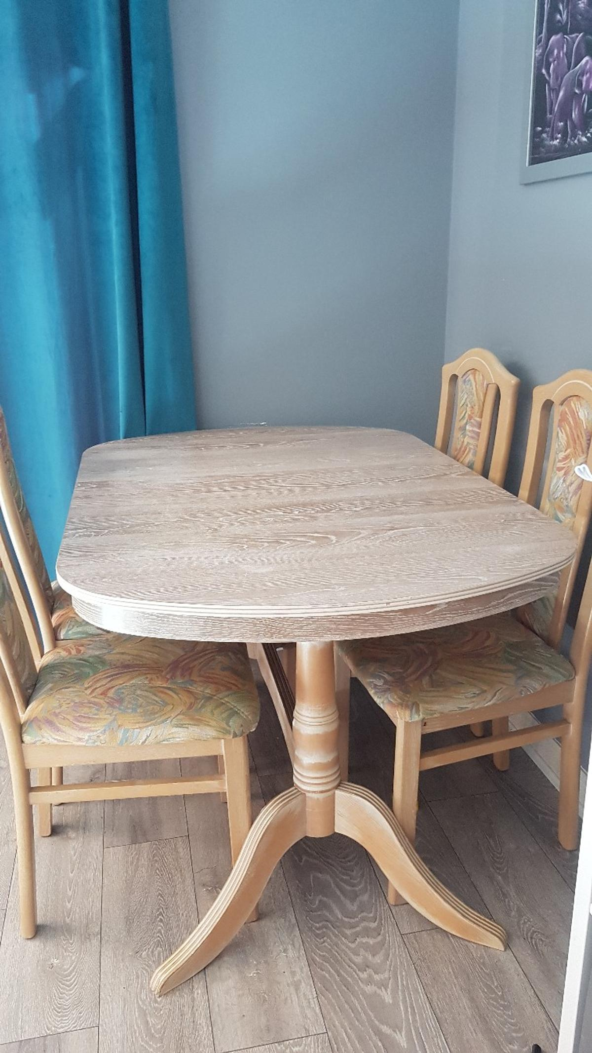 Solid rose gold table and 6 chairs. Really good condition apart from damage to 1 chair which is shown in picture. Extendable. Measures: 31 inches high 36.5 inches wide 56 inches long 70 inches long when extended  Great piece of furniture. Only selling as too big for new home.