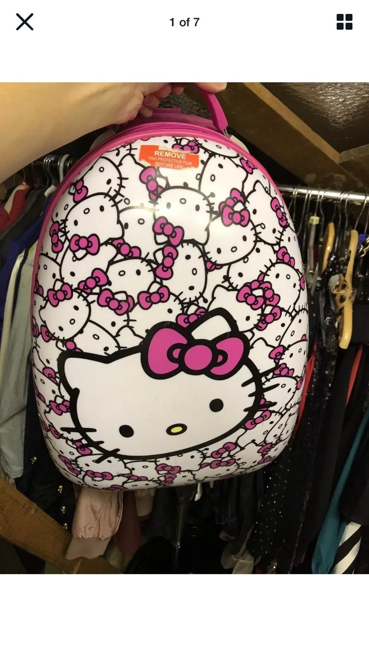 Hello kitty suit case cabin with light up wheels has been used and with the expected signs please see photos. All functional