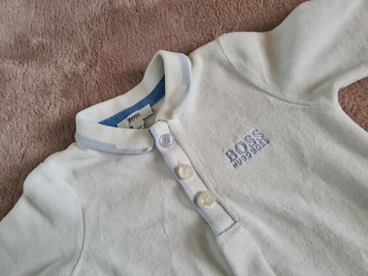 genuine hugo boss 0-3 sleepsuit this is true to size as Hugo boss does come up quite small. its velvet type material so ideal for winter  freshly washed in non-bio smoke free home  collection or postal  le3 braunstone- le3 Gallards Hill  postal £4 tracked and signed for will combine postage were possible  sorry no offers asking price only thank you