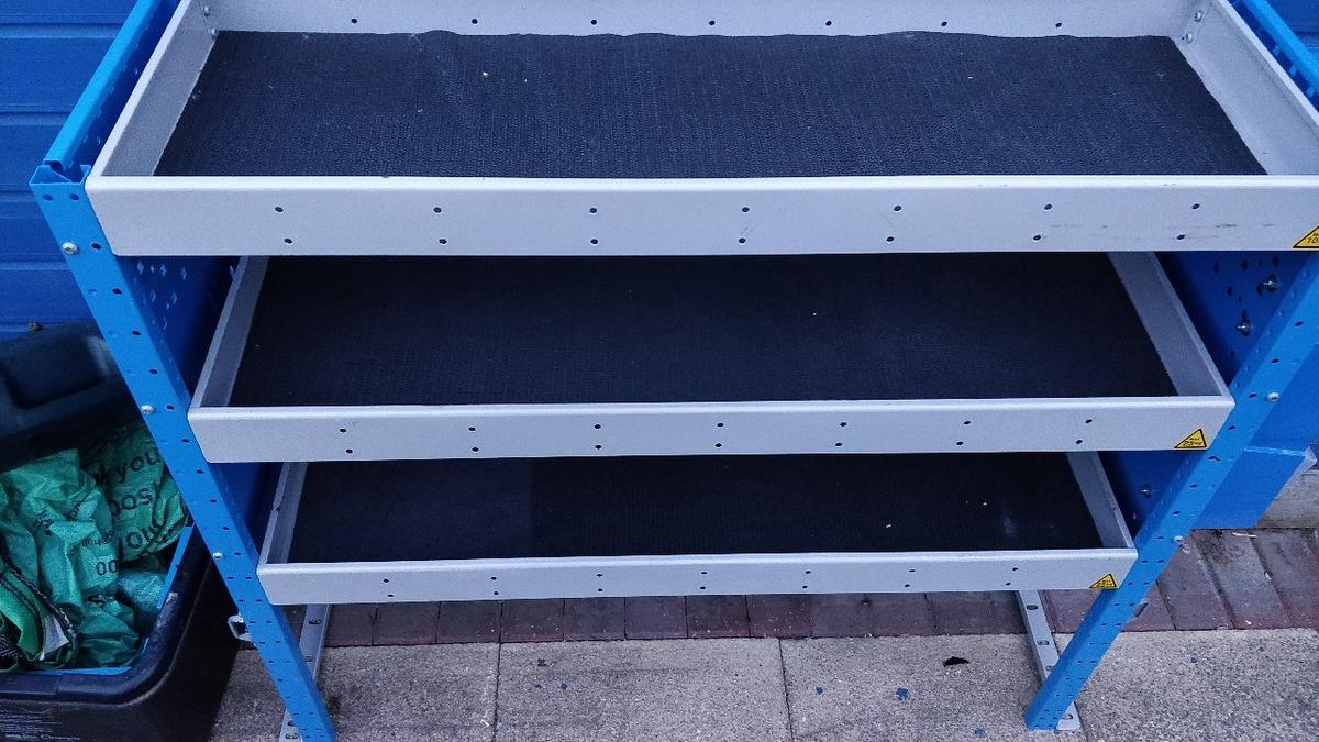 shelve system with storage at one end with shelve liner's in excellent condition no rust or dents