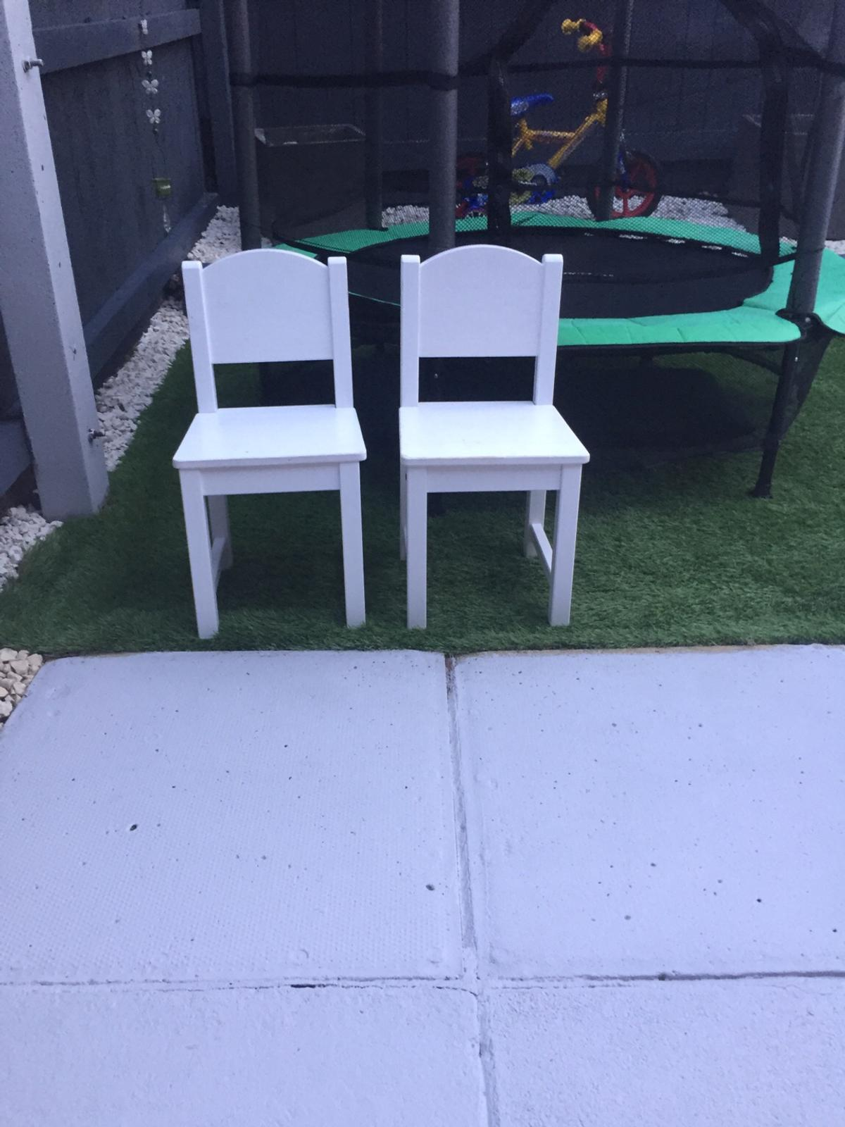 2 kids white wooden chairs , nice condition , lovely for garden or indoors , can deliver locally for small fee to cover petrol costs or pick up free