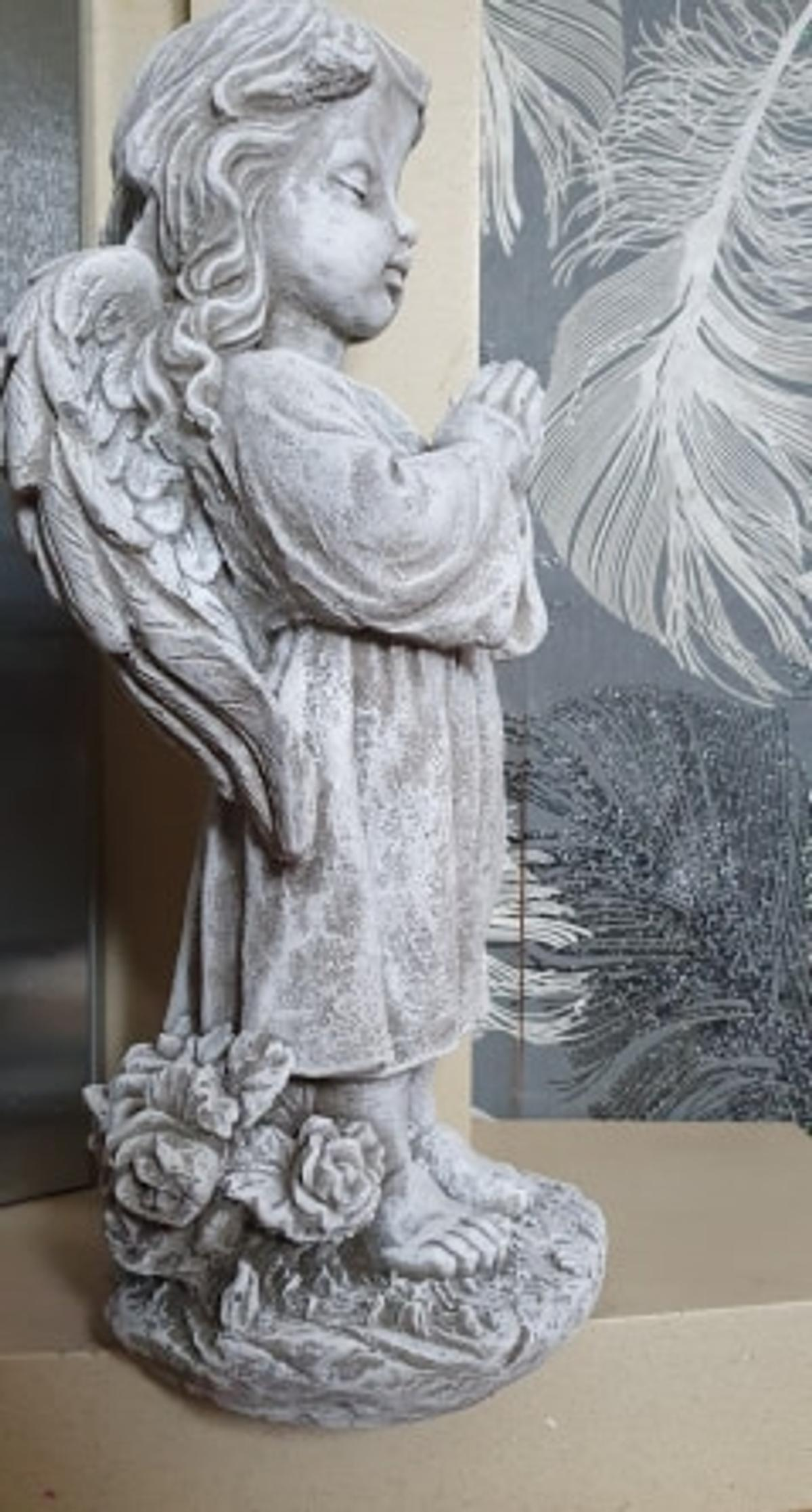 £12 each angel stone ornament is approximately 48 cm high 24 cm length 20 cm width Weight 11 kg These are £12 each All are garden ornaments are made from premium sand cement and stone with added frost protection