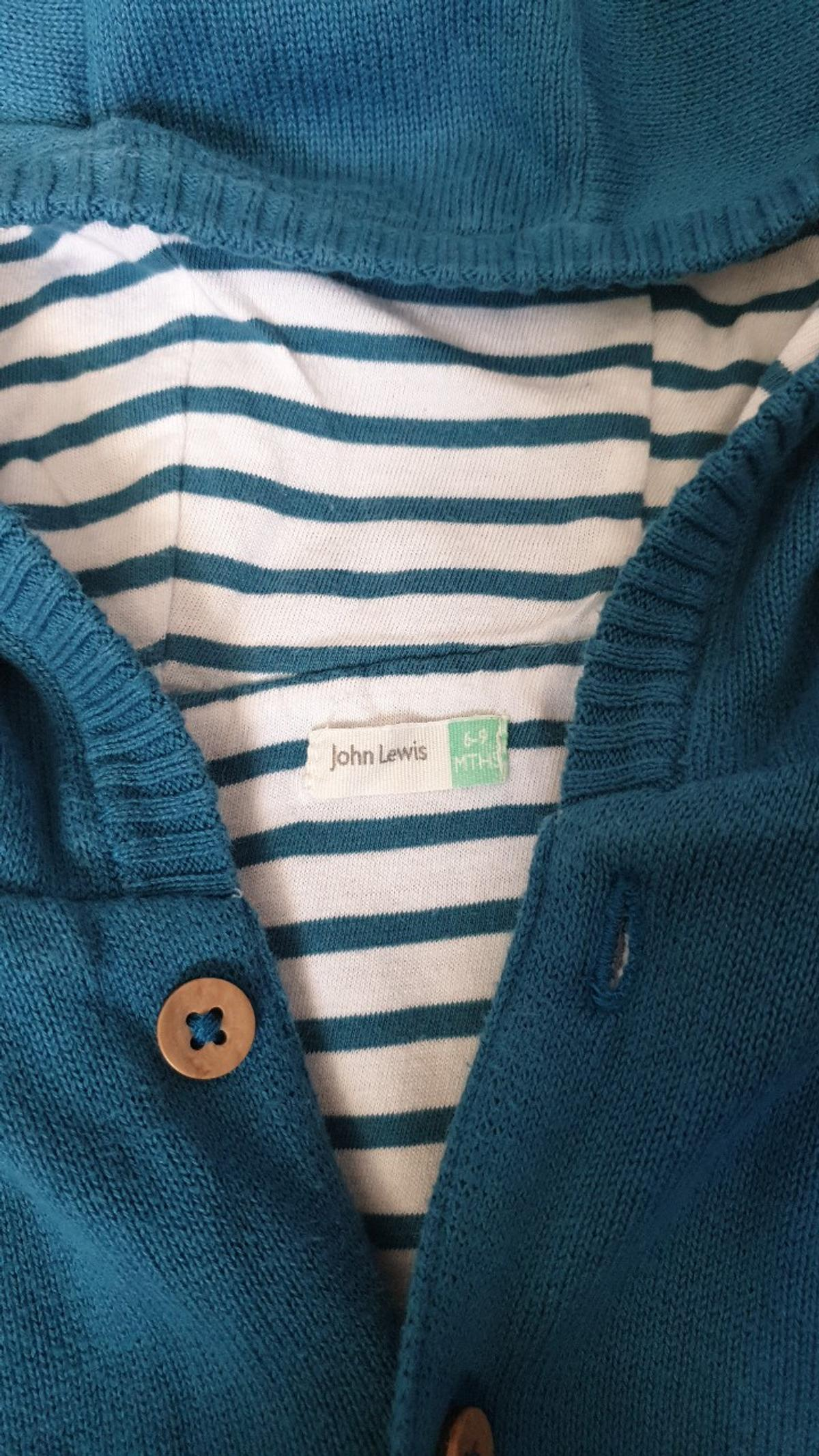 lovely cardi/summer jacket with good. buttons up. lots of wear left in it. quick sale.