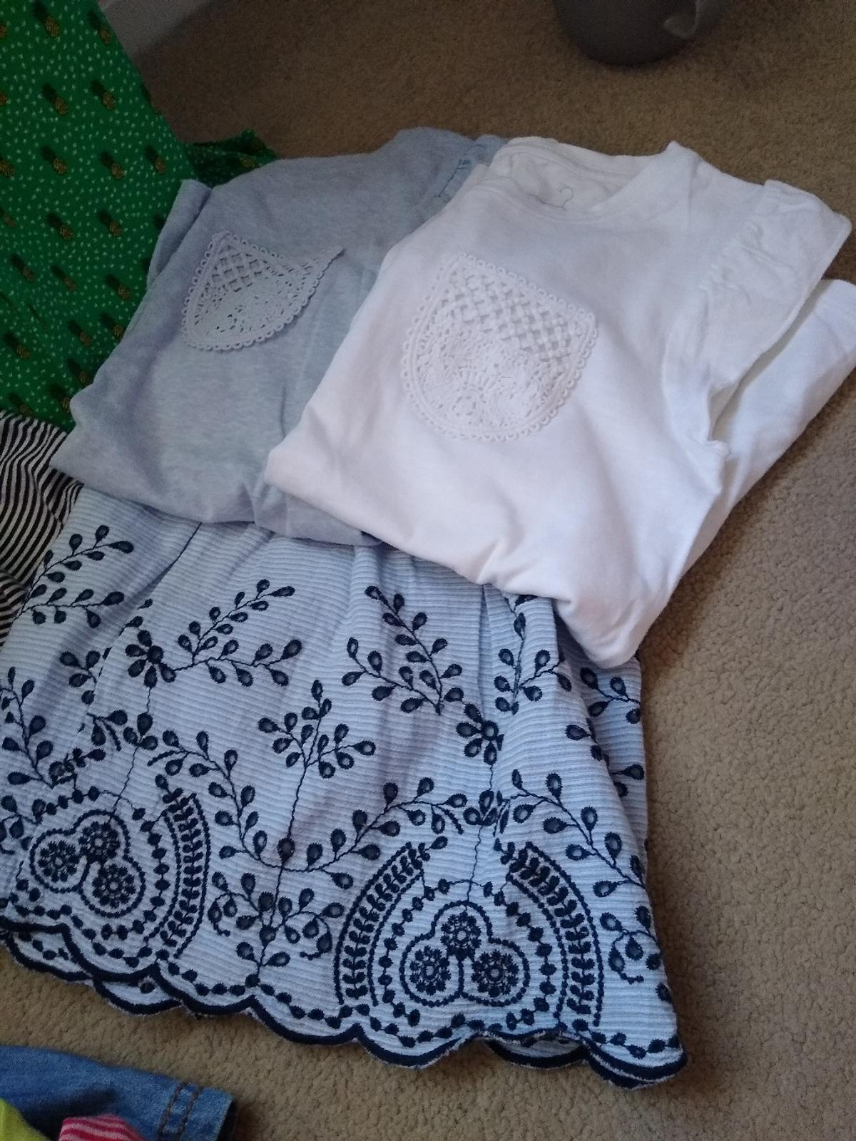 Mostly from Next includes 6 dresses, two skirts, 3 leggings, pink jeans still with label7 tops (incl one Shopkins), pair of shorts with matching top. All in excellent condition.