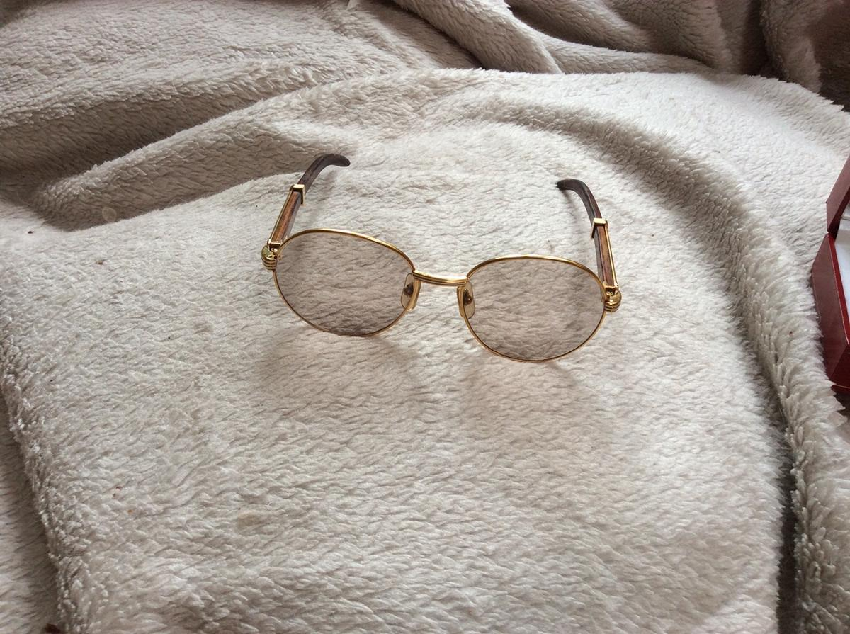 Ladies Cartier sunglasses. My stylish genuine Cartier sunglasses, are from the 1990's. Gold plated with wooden arms. Hardly worn. Complete with box and warranty document, which has not been filled in and registered with Cartier