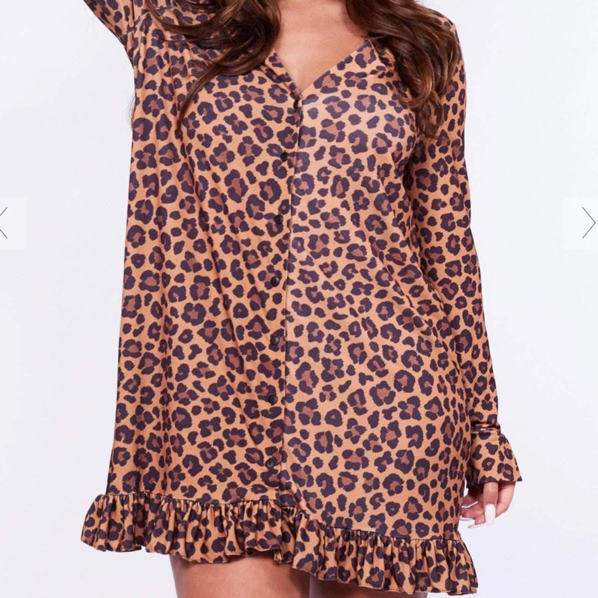 Brand new Never worn  Leopard print v neck button mini dress Frill hem Postage and collection can be arranged  Size: 14 Stretchy material