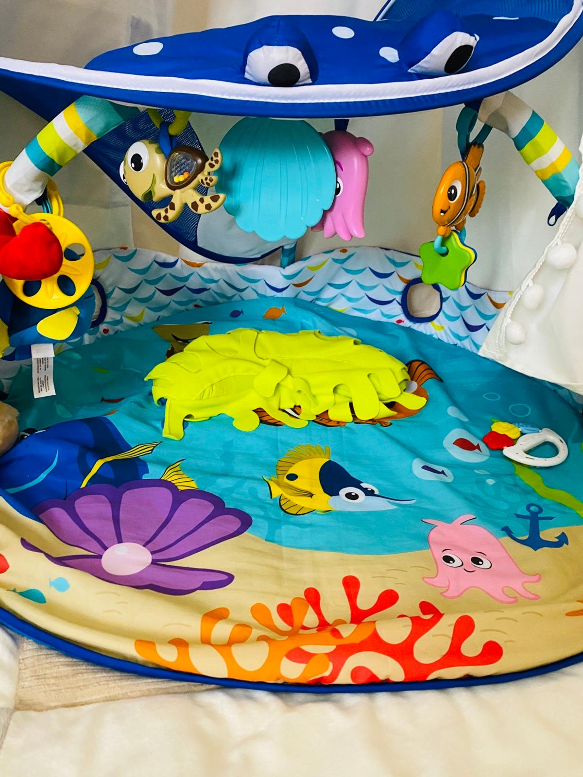 Finding Nemo activity play mat gym. In excellent condition this play mat is ideal to entertain your baby since she's just 3-4 months old. I had my baby staying in this one since she was just 3 months and she spent a lovely time inside entertained by music and lights from a magic underworld. It is a great way to make your baby enjoy playing by himself. It is only for collection because I don't have the initial package. It is complete and no damage at all. Smoke and pet free house.