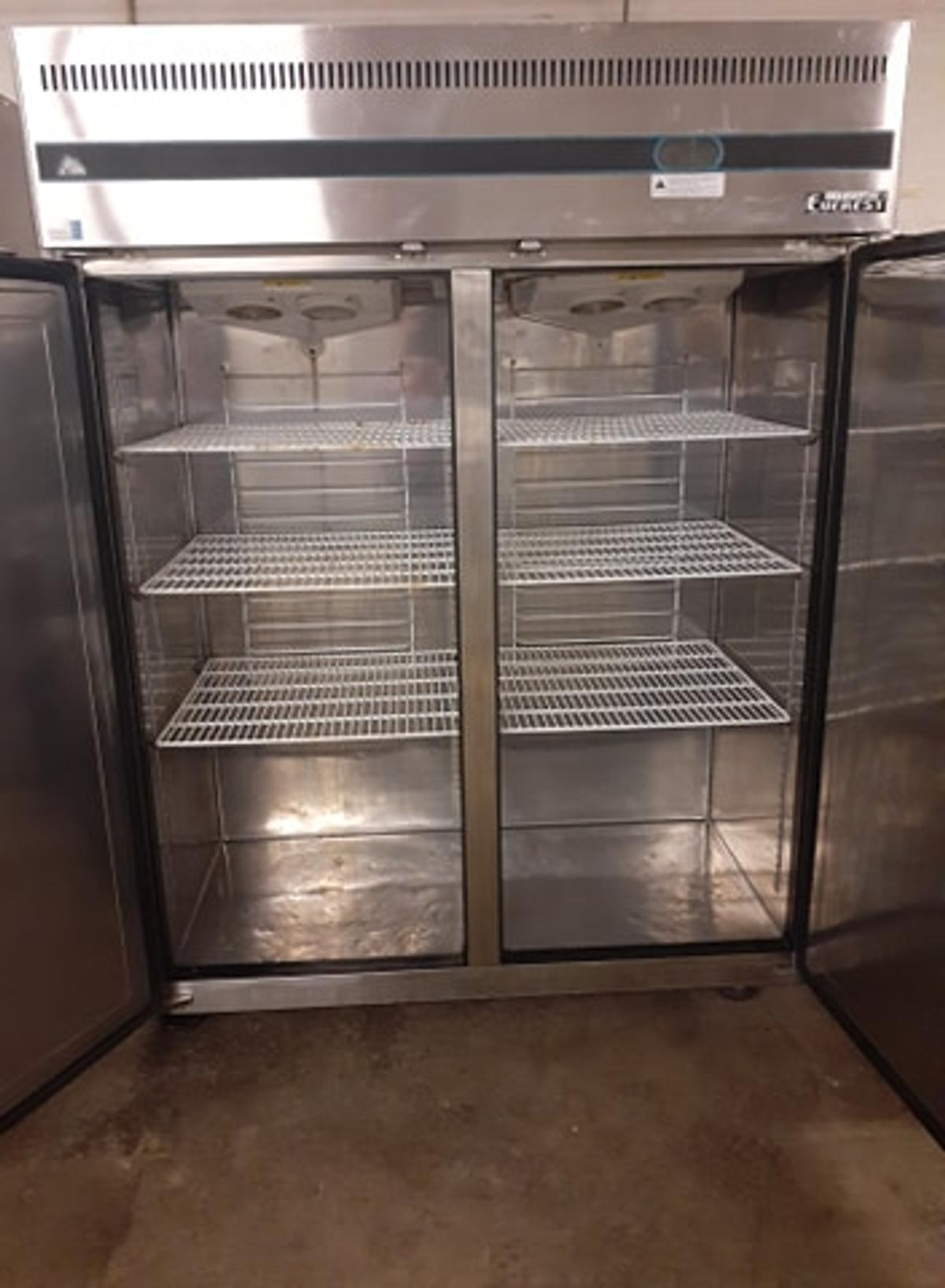 5 pc. commercial restaurant equipment. Includes an Everest one door cooler, an Everest two door freezer, two large Luxus coffee urns and a True prep table with two door cooler underneath. All stainless steel, cash only.