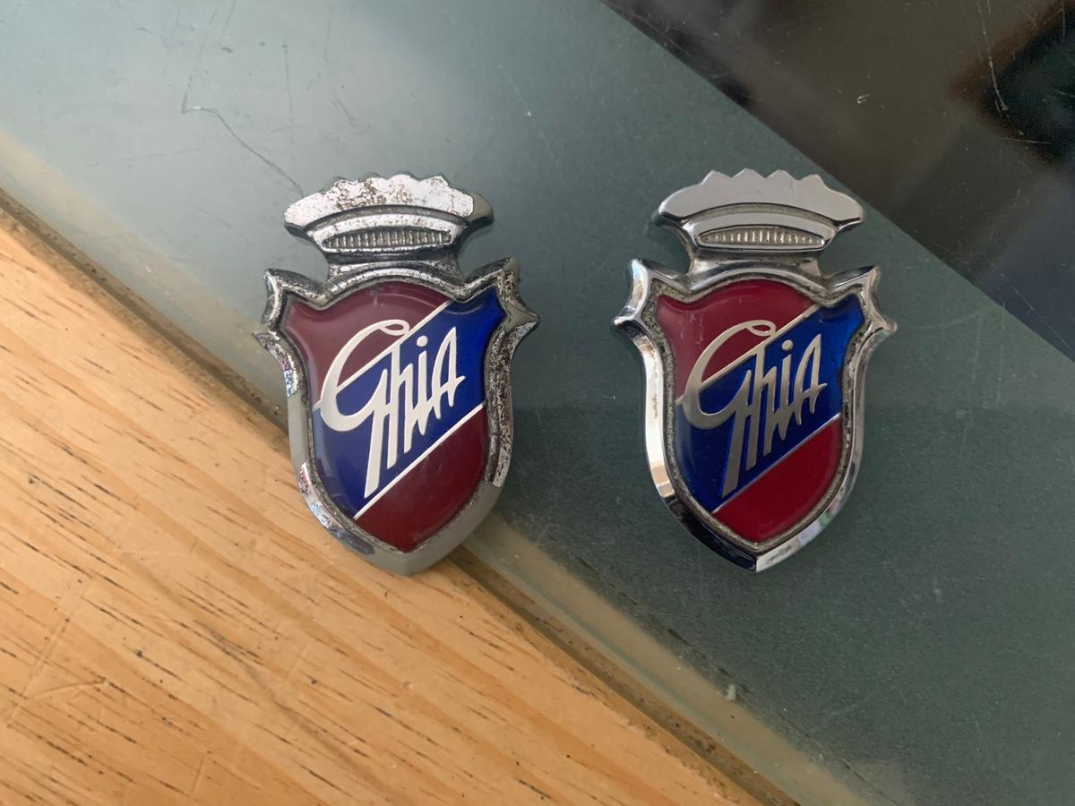 Two vintage ford ghia car badges one in good condition the other the silver is missing and marked in places they are the stick on ones