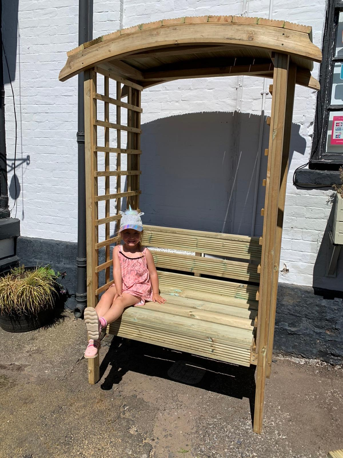 Wooden arbour garden seat unpainted but can be done in a dark varnish finish if needed. These as well as other items can also be made to order. Collection of possible delivery but please ask for delivery availability. Sizes are height 7 ft x width 56 inches x depth 27.5 inches.