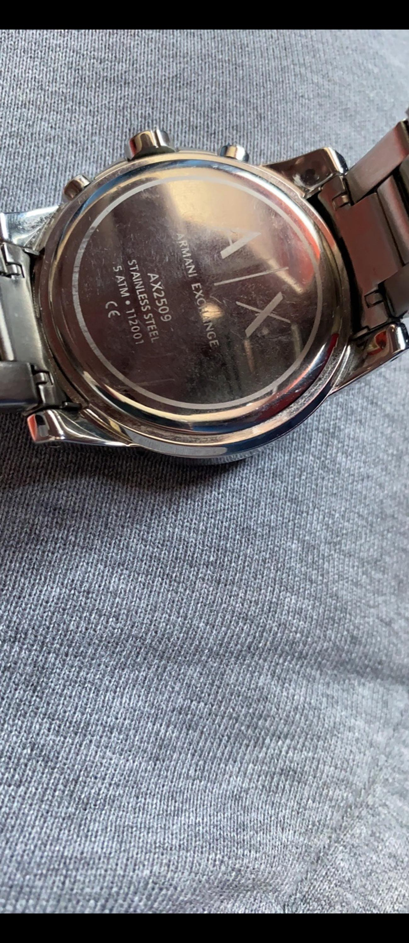 Brand new Armani watch took out box once to take pictures for sale unwanted gift receipt says it cost 180 new so would like to get like 110-130 all offers welcome as long as they arnt silly just want gone need the money