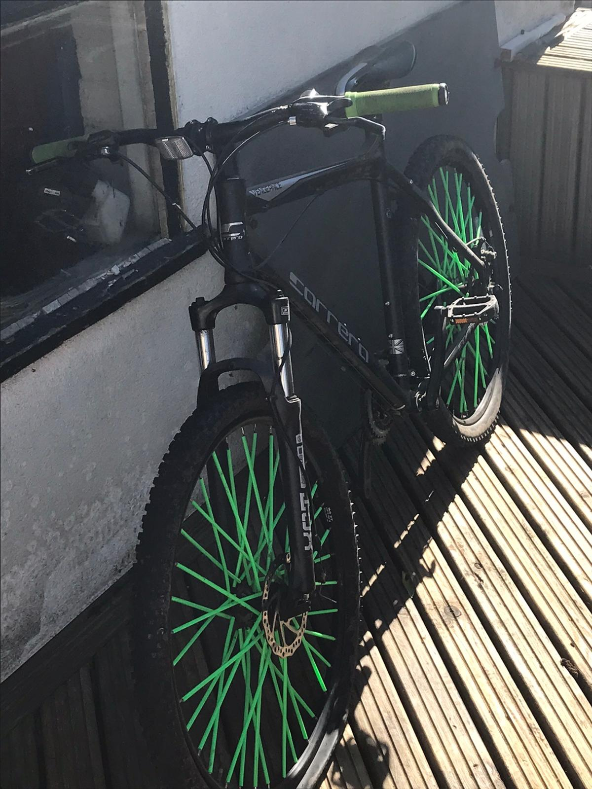Had this bike for 2 years and don't use it anymore. Front wheel needs a new inner tube but doesn't cost much to replace. Has green ODI grips on and green spoke covers which can be removed easily. Open to offers.