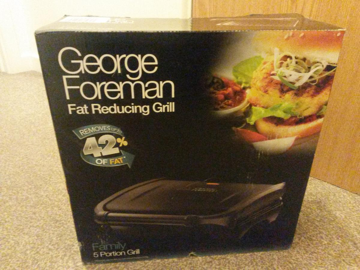 An appliance for those who love a healthier grilled meal. Boxed, barely used George Foreman family grill.