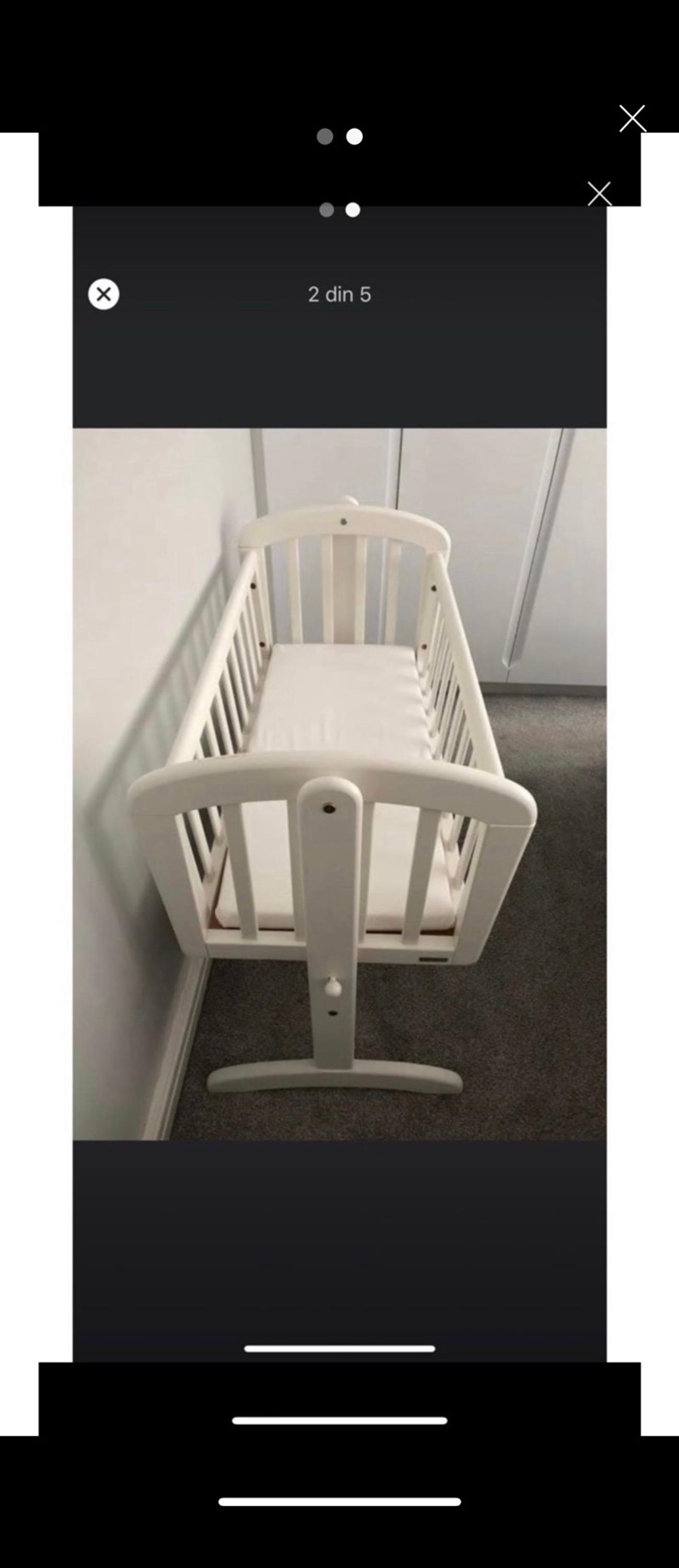 We found this useful before transitioning to a full size cot. Much more snug for a newborn/young baby and ideal for bedside. Has a few marks but does not affect use.  Fits in hatchback car with seats down without dismantling.