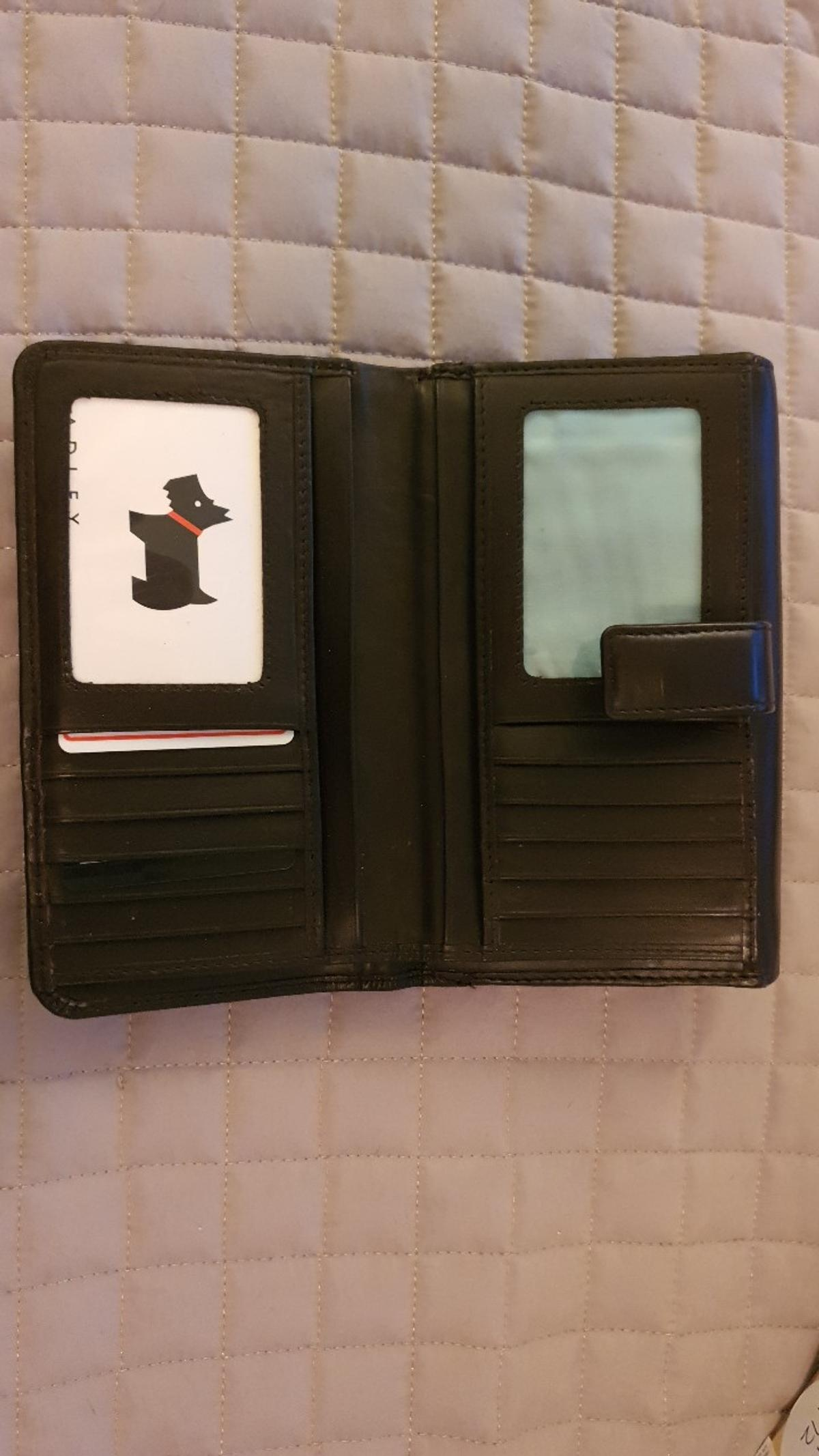 Genuine Radley Purse Black/Brown Style 81573 2 zip sections Card holder section Notes holder section Minimal scuff on rear as shown in pictures otherwise in excellent condition.