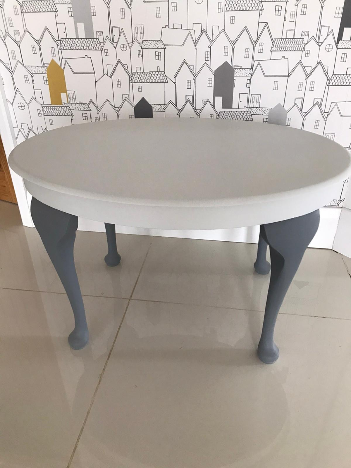 Small oval table with ornate shaped legs. Painted in wolf whistle and greyhound Frenchic chalk paint. Measures 68 cm x 49 cm. 42.5 cm h. Can collect from driveway.