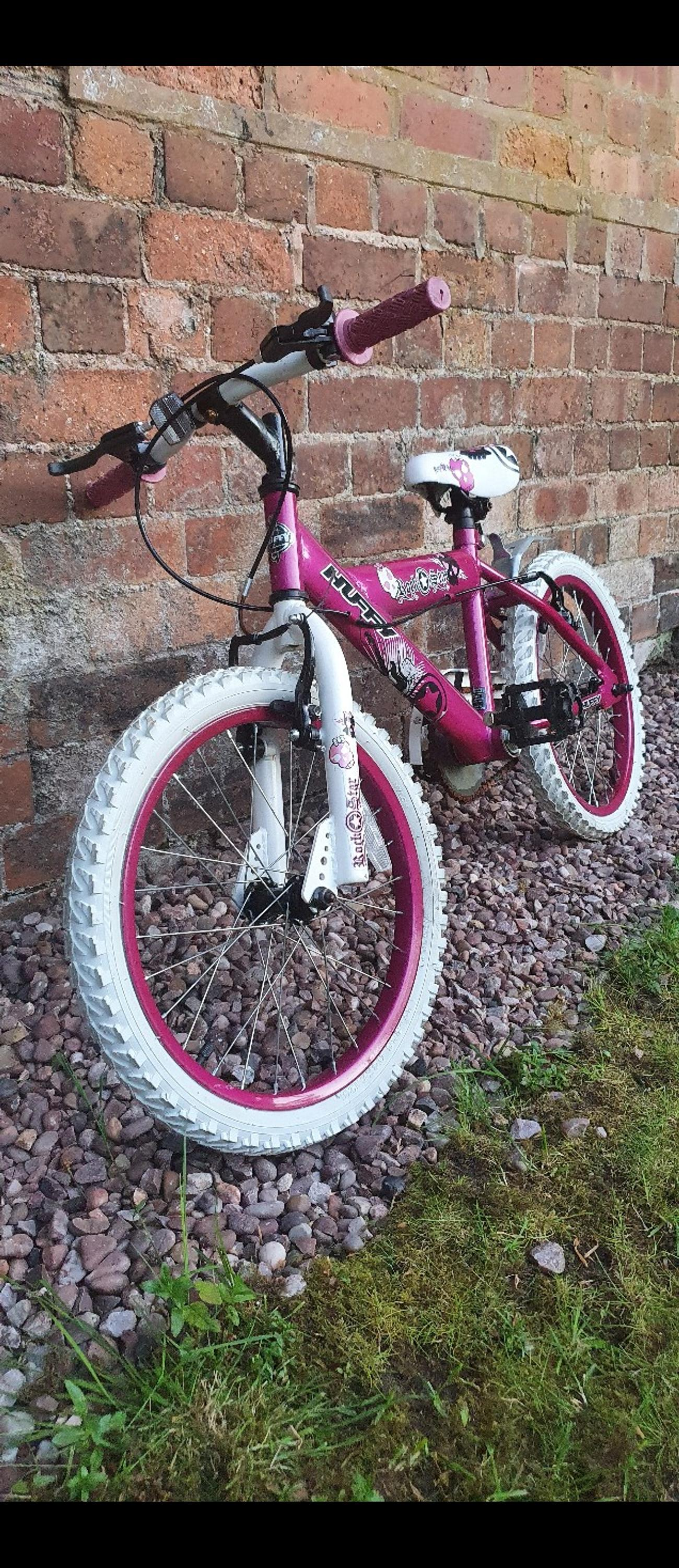 fair condition girls purple bike, in need of a bit of TLC and a clean. I've re-oiled all moving parts tyres will need pumping up. there is a doll seat that attaches to the back which I have put back on but can be taken off again. bargain priced to sell quick.