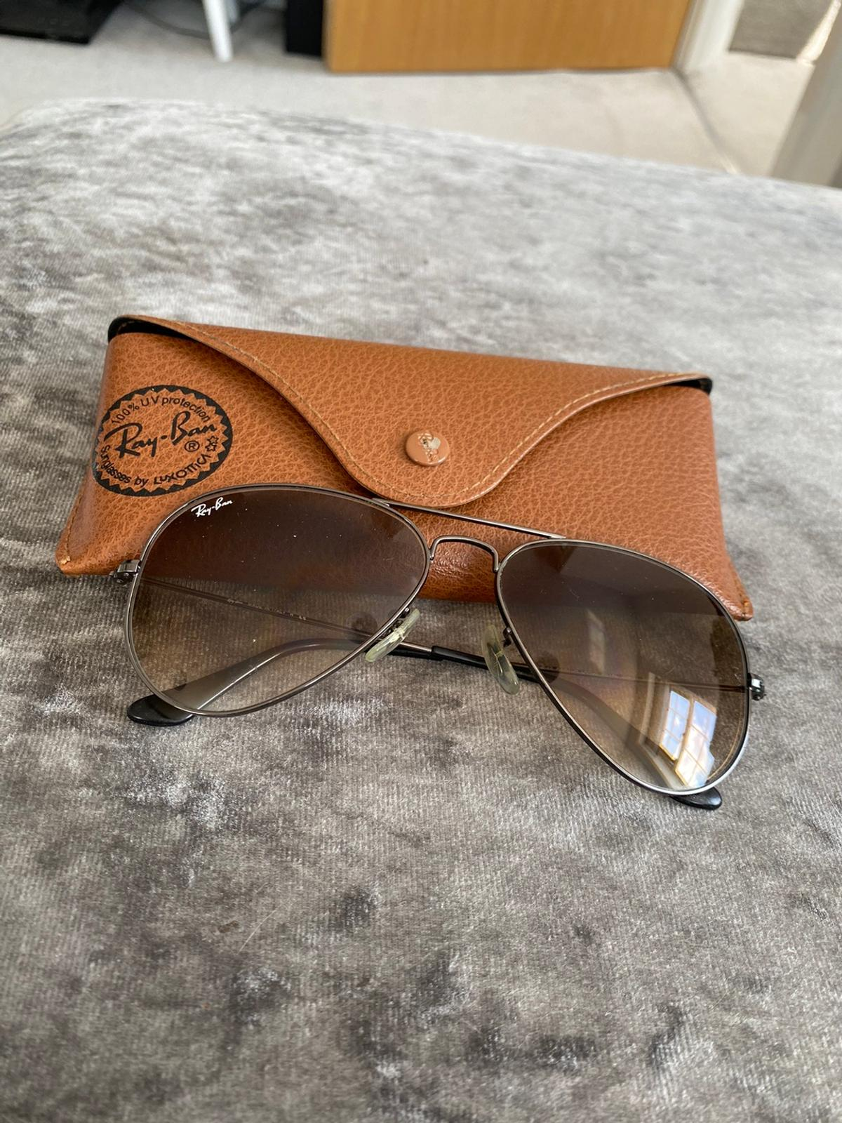Genuine RayBan Sunglasses, they have a brown lens tint and come with original leather case.  'RB' etched into the left lens to show authenticity  Inspections welcome.  I can deliver locally for a small charge