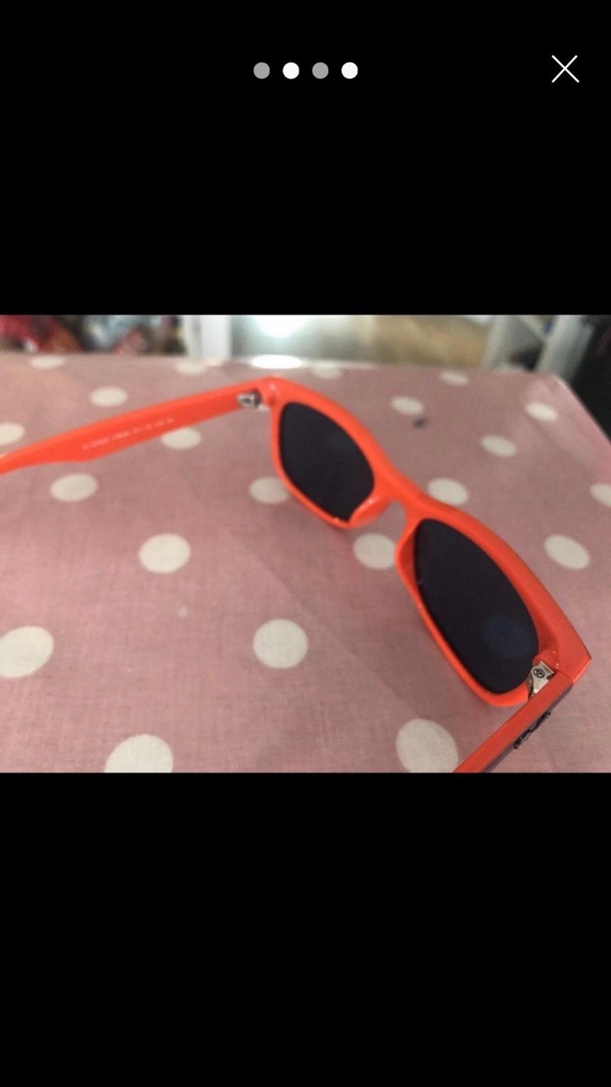 Navy and orange children's Raybans. Worn once. Paid £96 excellent condition