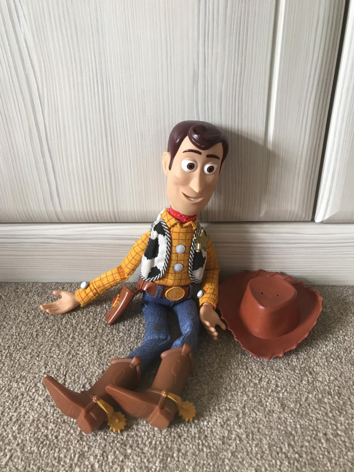 A well loved Woody. In good condition, with clear working voice box.