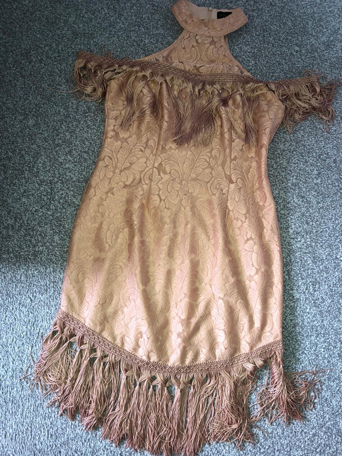 Size 12 in the style cold shoulder tassel dress worn once