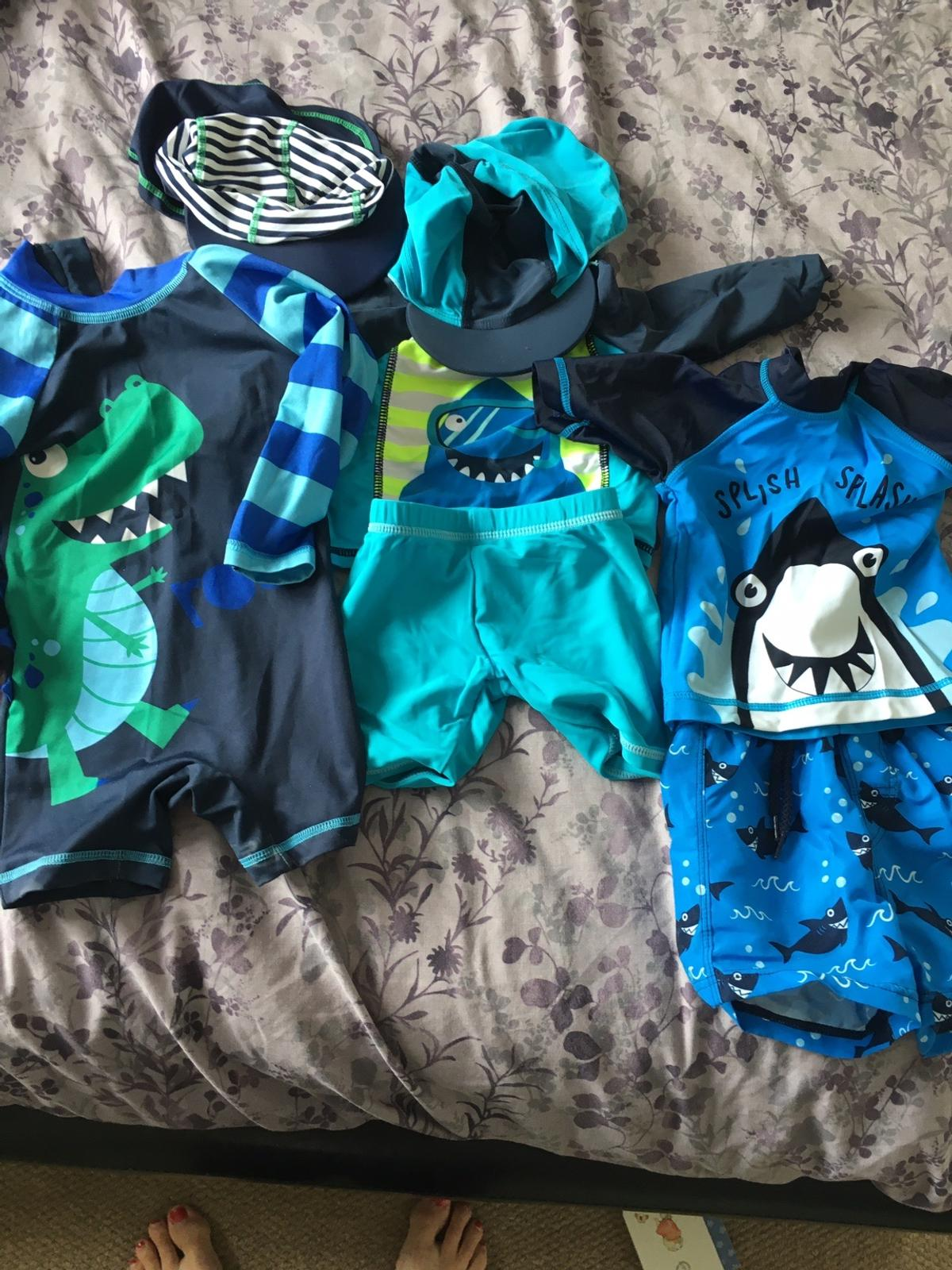 One all in one swimsuit (long sleeved) Two shorts and top Two swim hats