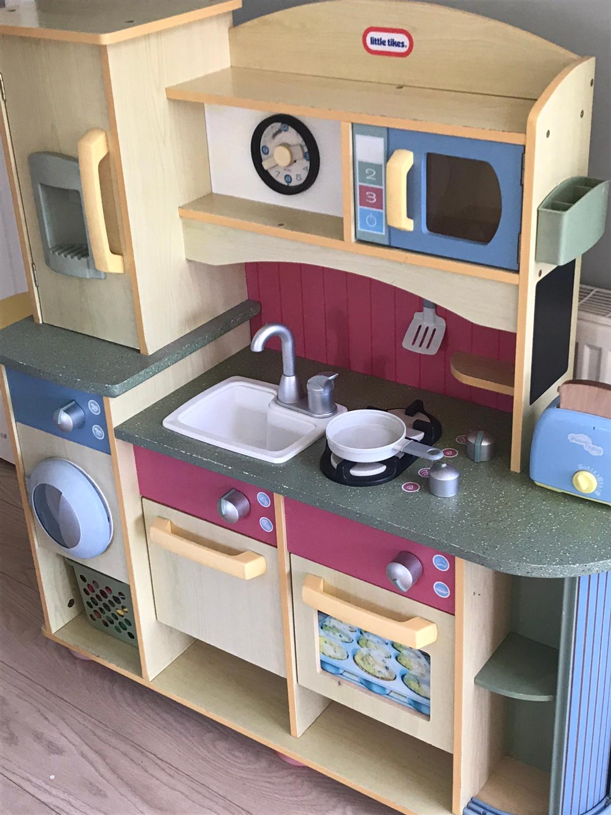 Lovely used wood children's kitchen. Pull out shelf Washing machine Fridge Dishwasher Oven with 2-way baked / unbaked image Sink Job Cupboard Microwave  Some food / kitchen accessories included  Height 102cm Width 98cm Depth 35cm  Collection only