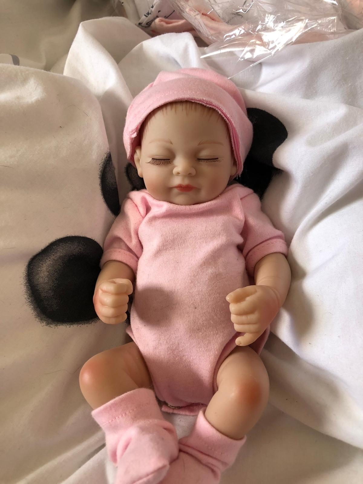 Authentic reborn doll for sale never been played with has been shelved. Pretty much new