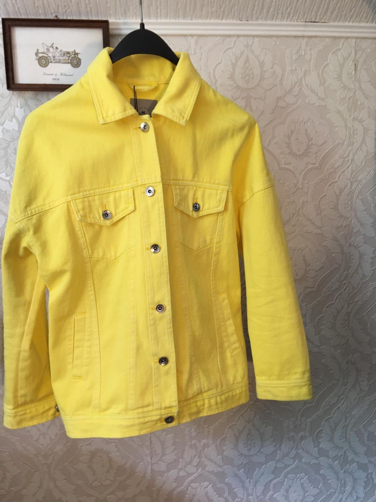 It's a bright yellow Denim Jacket it's pretty new The tag isn't removed yet and it looks perfect