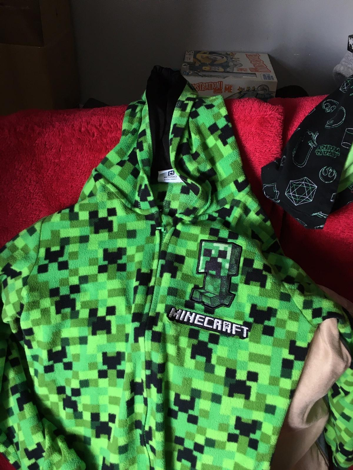 Minecraft onesie 10-11 Star Wars onesie 9-10, zip only goes half way down but can still be worn and zipped up  Can deliver in Leeds at a small fee to cover fuel