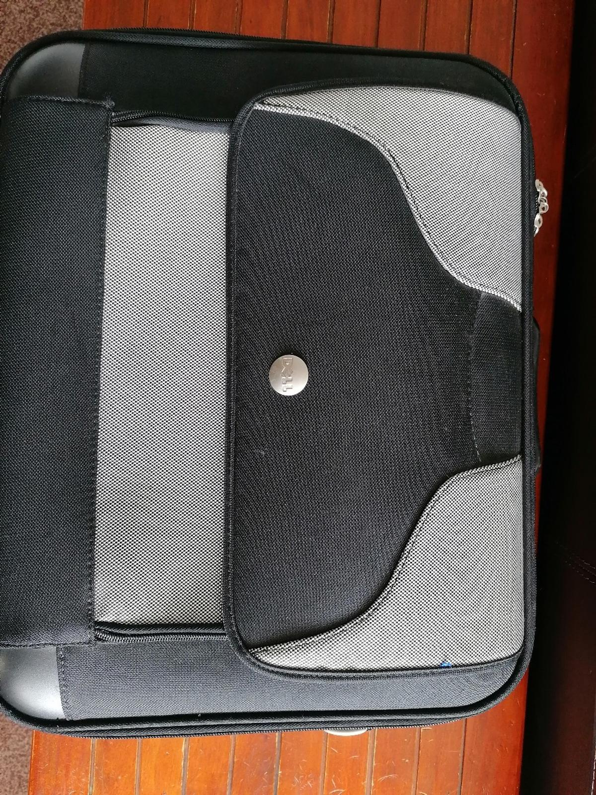Strong, sturdy laptop bag. Still in excellent condition as hardly used. Has an optional strap use too. I've put price up a bit as postage will be more than £4. Price can be negotiated if picking up.
