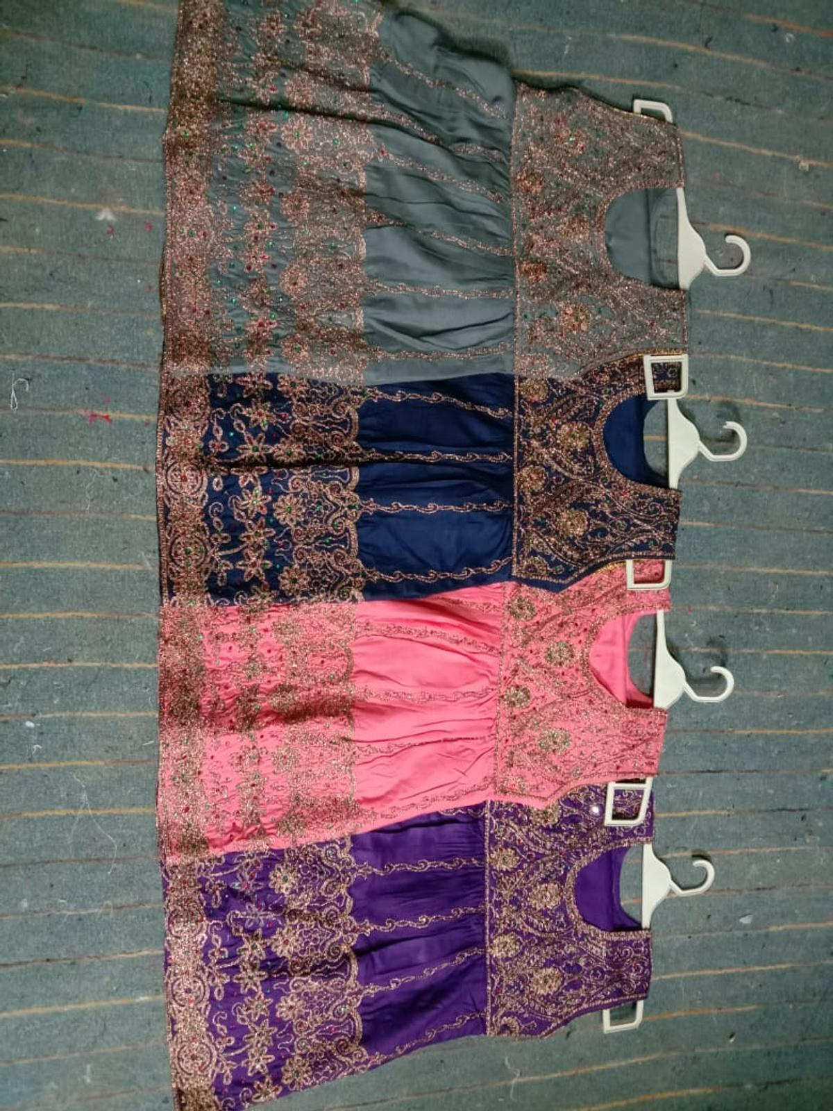 girl suits on Ahmed's collection's Burnley bb101xh price only £12. 00 each suit .07462080493