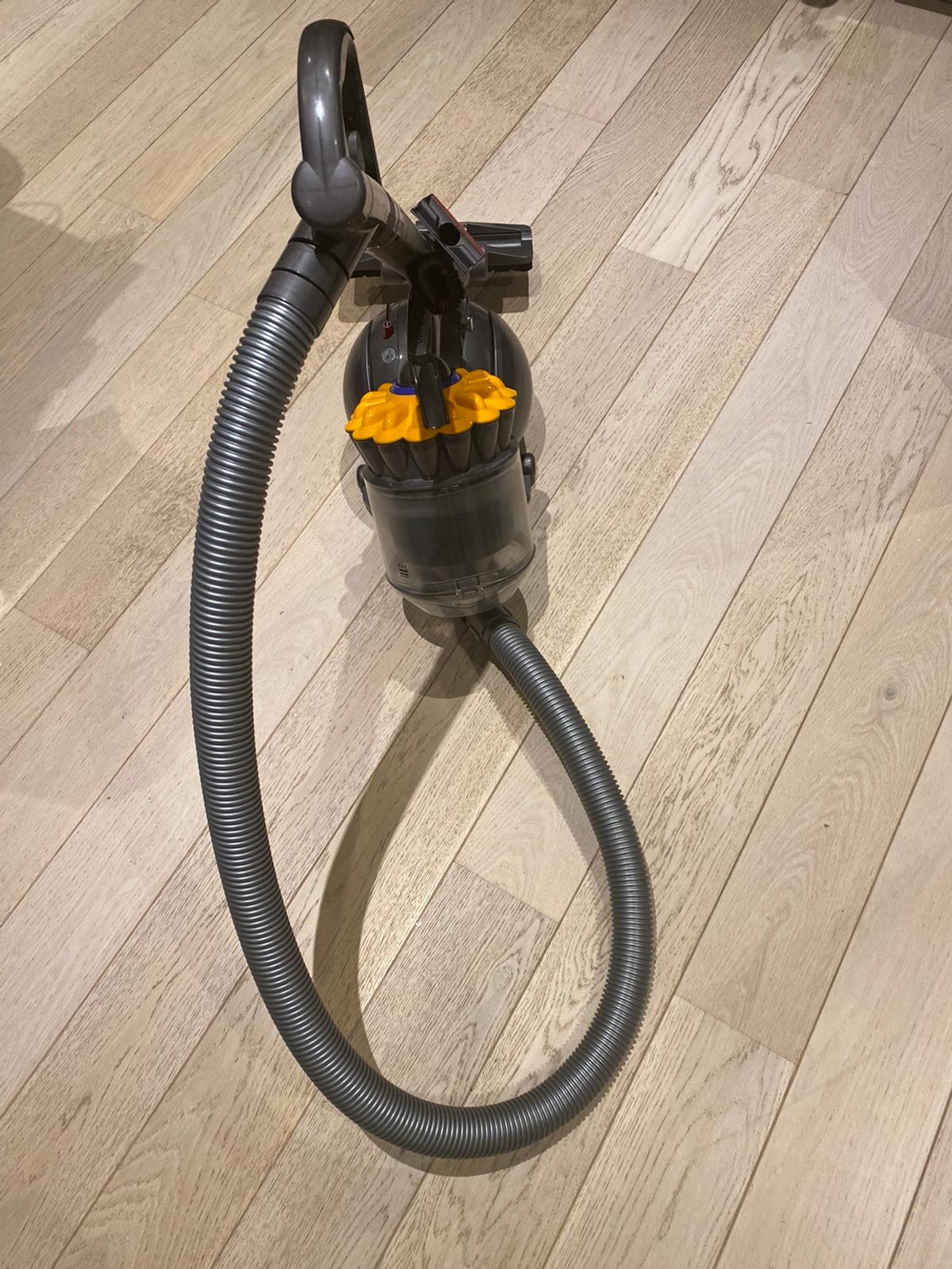 Used - but brilliant - Dyson ball multi surface vacuum. Nothing wrong with this, I replaced it with the new handheld dyson. This one comes with two attachments. It's in perfect working order. Genuine product - I bought it from John Lewis. I think it was about £400.  I can post with a courier or you can collect - safely.