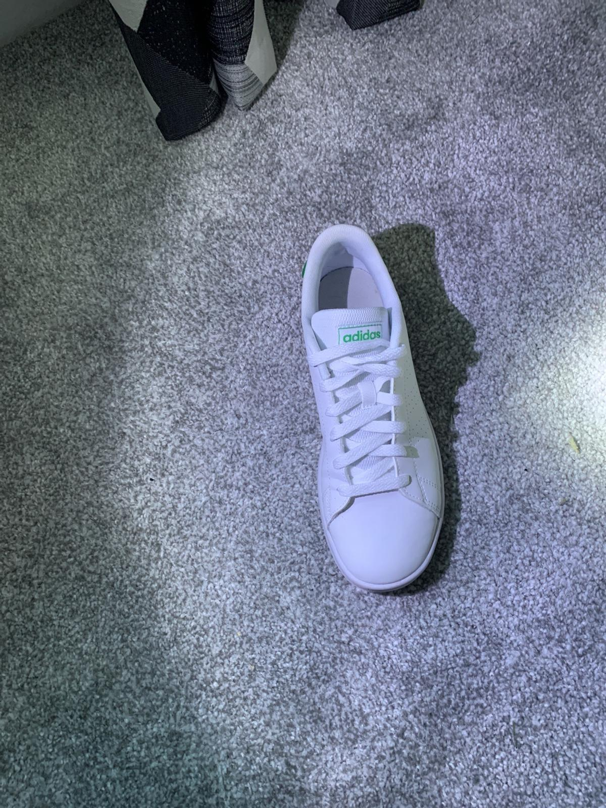 Green and white junior size 5 Adidas trainers